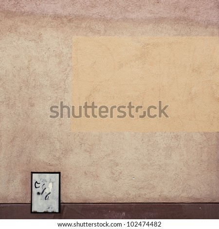 Urban grungy street wall, may be used as background or texture
