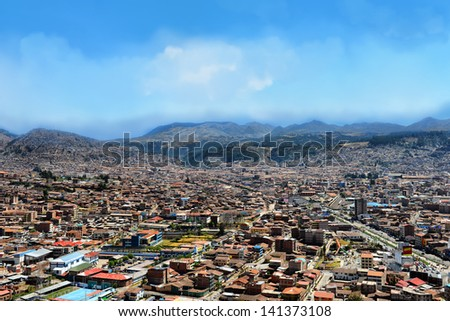 Urban landscape of Cusco, Peru. A view from a mountain.