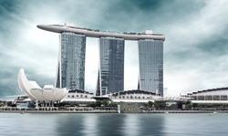 urban landscape of Singapore under a cloudy sky