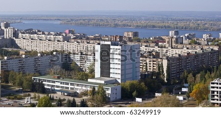 Urban landscape. Typical residential area on the riverbank. The view from the heights in the background the river Volga and Zhiguli Mountains. Russia.