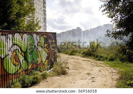 Urban landscape with  graffiti. Road and building
