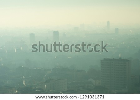Urban landscape with smog. Aerial view of city with polluted air.
