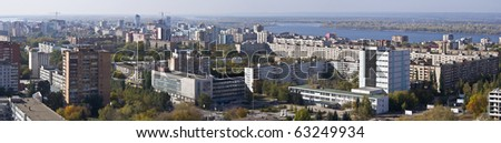 Urban landscape. XXL Size. Typical residential area on the riverbank. The view from the heights in the background the river Volga and Zhiguli Mountains. Russia.