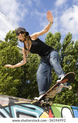 Urban life - Beautiful young women with skateboard