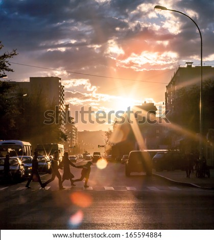 Urban life in vain hour before sunset, the city of Astana Kazakhstan. To me these shots especially the road. Picture which can be called art.
