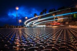 Urban night landscape with blurry car headlights