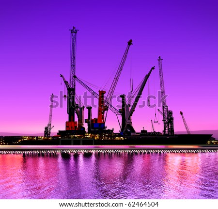 urban night view of the shipyards with cranes