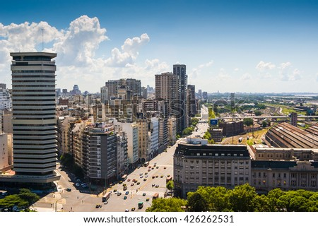 Urban panoramic view of traffic in modern summer downtown with skycrapers in the city of Buenos Aires, Argentina