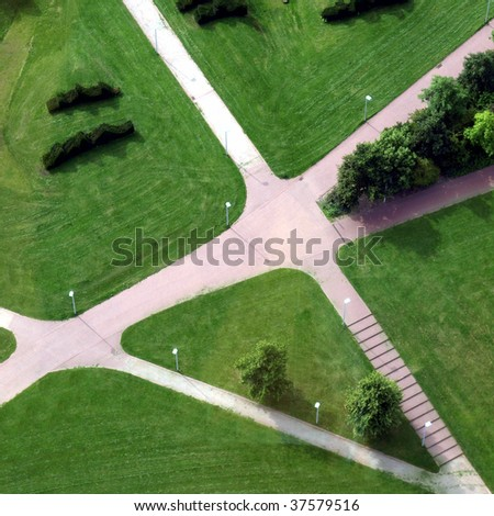 Urban park with meadow, trees and paths