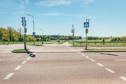 Urban pedestrian crossing with traffic lights.