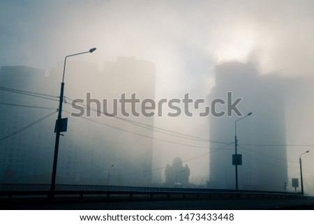 Urban perspectives. Misty modern city street. Sunlight through the fog among high buildings at residential district. Kyiv. Ukraine. #1473433448