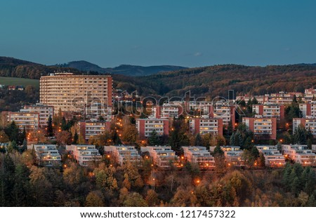 Urban photography of typical residential buildings of inhabitans in the city Zlin, Czech Republic, Europe. Picture taken during blue hour with blue sky make a nice image of this Bata town. #1217457322