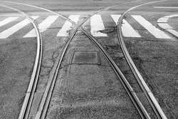Urban railroad of Milan's tram (an urban mean of transport) splitting in two directions. Left or right? Monochromatic with copy-space
