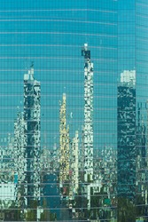 Urban reflections An urban skyline reflecting in a glass highrise office building