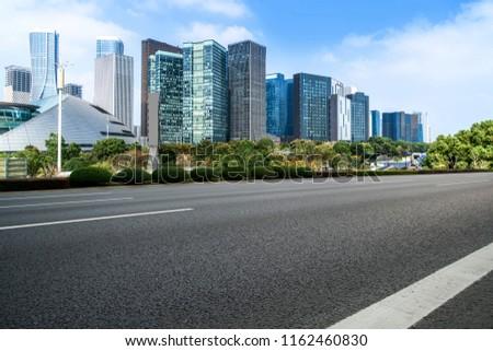 Urban road asphalt pavement and skyline of Hangzhou urban constr