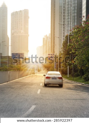 Urban road with sunset