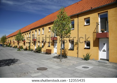stock-photo-urban-row-house-in-pedestrian-street-denmark-12355435.jpg