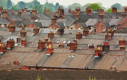 Urban scene across built up residential area of terraced houses showing the slate roof tops of an old housing estate