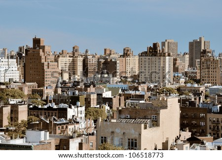 Urban scene of high rises in Lower Manhattan viewed from a Chelsea rooftop