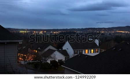 Urban scene with city lights in the background.