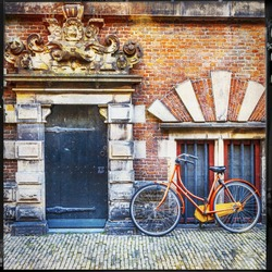 urban scenery of Holland. old door with bisycle