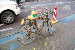 Urban sculpture. A bicycle decorated with little ducklings. Bicycle on the cobblestone sidewalk. October 01, 2015, Brussels, Belgium