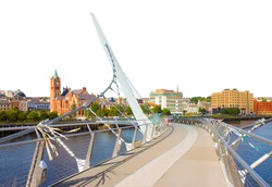 Urban skyline of DERRY city, also called LONDONDERRY, in northern IRELAND with the famous PEACE BRIDGE - Europe - Northern Ireland - concept on white background.