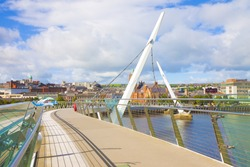 Urban skyline of Derry city (also called Londonderry) in northern Ireland with the famous