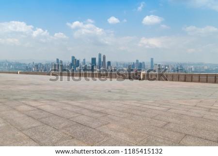 Urban skyscrapers with empty square floor tiles #1185415132