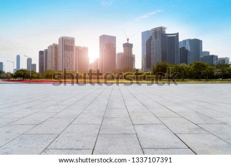 Urban skyscrapers with empty square floor tiles #1337107391