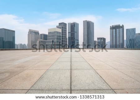 Urban skyscrapers with empty square floor tiles #1338571313