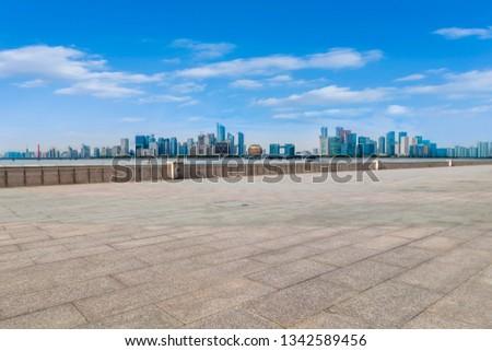 Urban skyscrapers with empty square floor tiles #1342589456