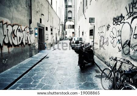 Urban slum. Narrow Italian street. High contrast effect.