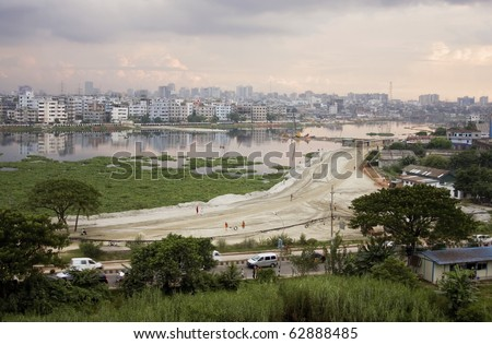 Urban Sprawl: a lake is gradually being filled up for building construction in capital city Dhaka, Bangladesh