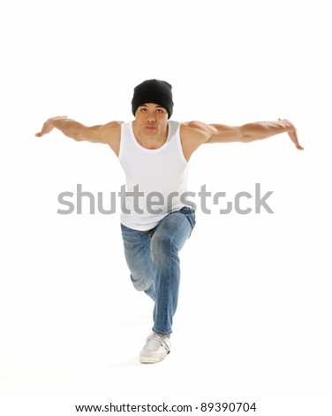 Urban style street breakdancing handstand grab move done isolated on white in studio