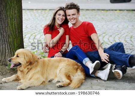 Urban stylish trendy young teenage people with dog