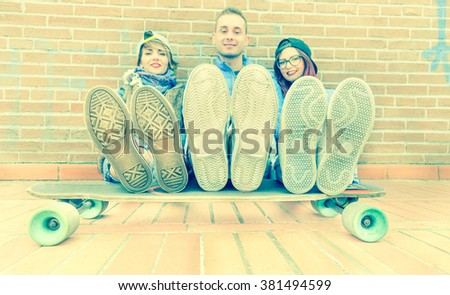 Urban stylish trendy young teenage people with legs on longboard - Happy skaters having fun together - Hipster lifestyle and new trends concept - Focus on shoes - Vintage filter