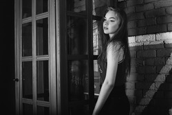 Urban stylish young girl monochrome portrait, woman beauty