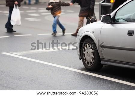urban traffic scene at a pedestrian crossing - stock photo