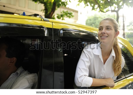 urban transport: happy female passenger inside of a taxi