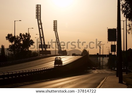 Urban view in sunset light with main road