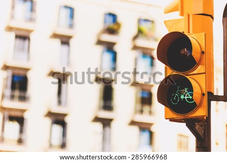 Urban yellow traffic lights and a pedestrian crossing on the blurred street background