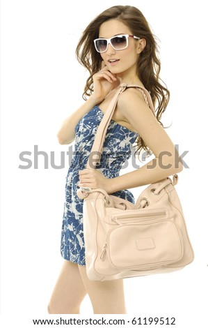 Urban young woman with modern a handbag posing
