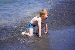Ureki, Georgia - July 8, 2021: Boy swims in the sea