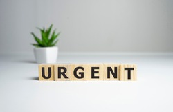 Urgent care word written on wood block. Urgent care text on wooden table for your desing, concept