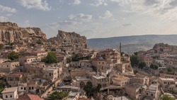 Urgup Town aerial view from Temenni Hill in Cappadocia Region of Turkey timelapse. Old houses and buildings in rocks at early morning panorama