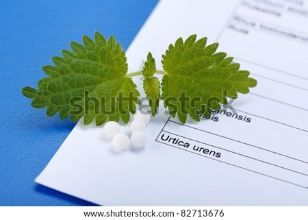 Urica Urens and homeopathic pills on homeopathy related sheet