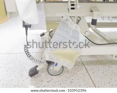 Urine bag or pee bag beside bed in hospital, urinary catheter (Foley Catheter)