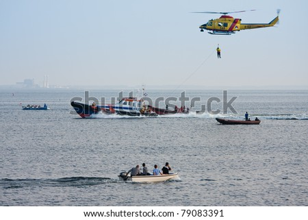 URK, THE NETHERLANDS - JUN 7: The lifeboat of Urk is practicing with a rescue helicopter of the Dutch Royal Airforce  on June 7, 2011 in the IJssellake near Urk, the Netherlands
