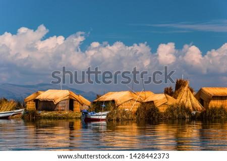 Uros Floating islands in Titikaka lake in the Border bttween Peru and Bolivia, Peru #1428442373